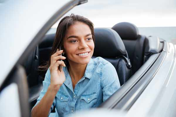 graphicstock beautiful happy woman driving car and talking on mobile phone Hd6sS3B3l 1 Lombard Koszalin